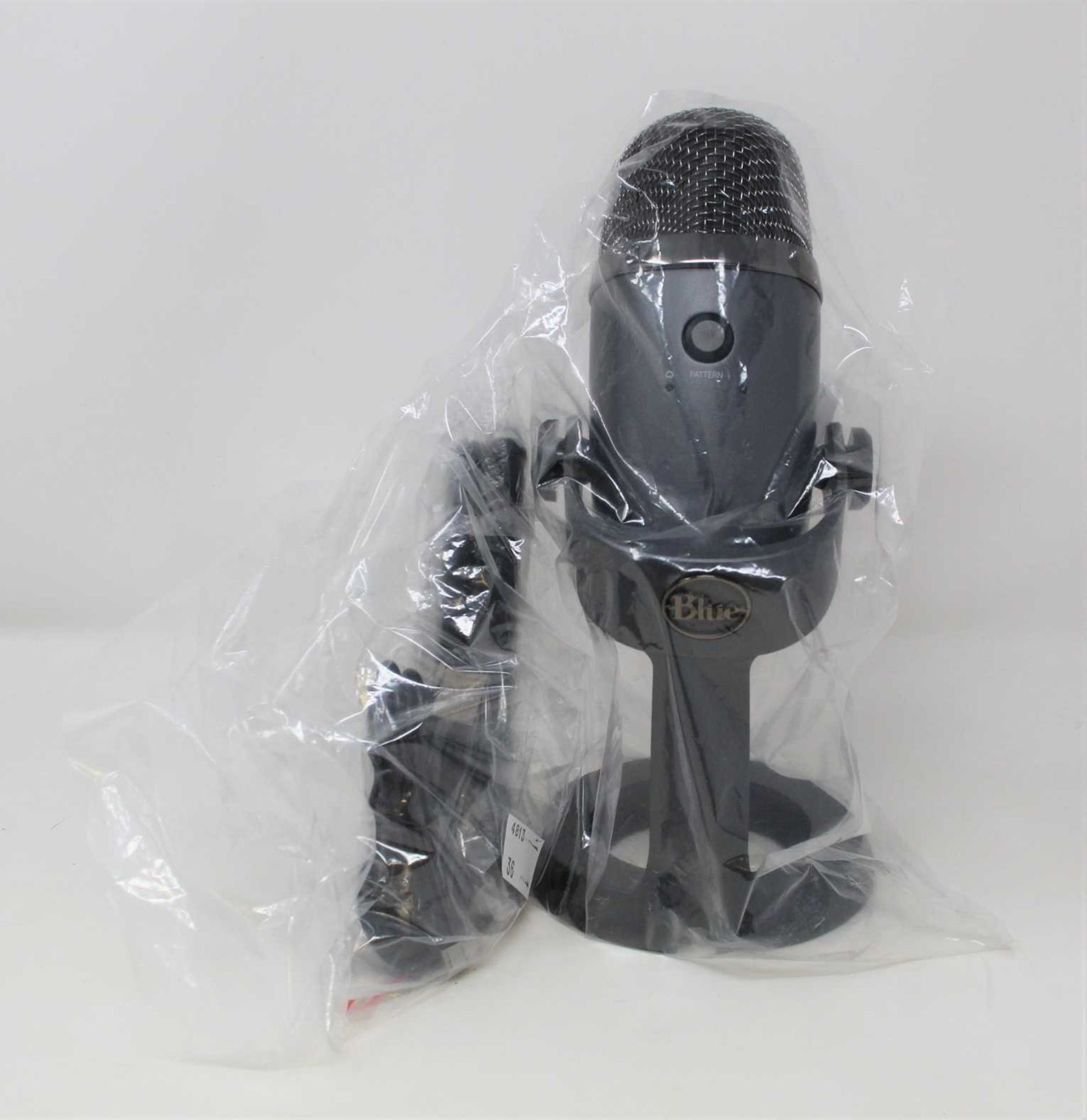 A pre-owned Blue Yeti Nano Premium Dual Pattern USB Microphone with stand and USB Cable.