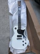 An as new Harley Benton electric guitar in white.