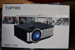A boxed as new Toptra video projector (Model TR20).
