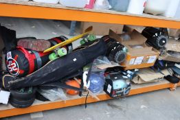A quantity of miscellaneous sports related items to include golf clubs, weights and fishing