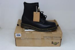 A pair of as new Dr Martens 1460 8 Eye boots (UK 6).