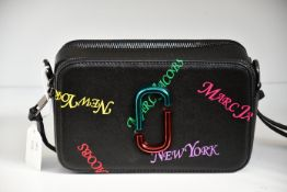 An as new Marc Jacobs camera bag in black.