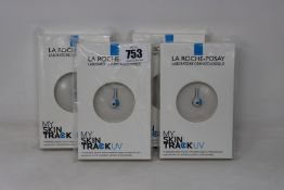 Four boxed as new La Roche-Posay My Skin Track UV wearable sensors.