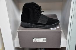 A pair of pre-owned Adidas Yeezy Boost 750 boots in black (UK 10.5 - Good condition).