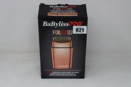 A boxed Babyliss PRO FoilFX02 double foil shaver (May require UK adaptor, some attachments may be