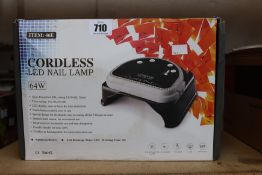 A boxed as new 64W cordless rechargeable LED nail lamp light gel polish nail dryer timer beauty.