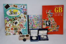 Coin and stamp collection including two silver proof crowns, twelve France 5f silver, plus others.