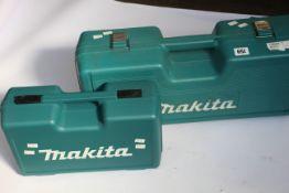 An as new Makita GA4530R Angle Grinder and a pre-owned Makita GA9020 Angle Grinder (Requires plug).