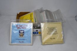 A box of coin collections and year sets, seventeen Royal Mint special pack for Guernsey, Jersey