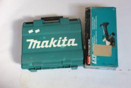 A Makita Rotary Hammer HR1840 and a boxed Makita Cordless Angle Grinder DGA452Z.
