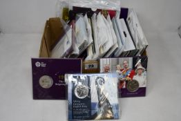 A box of £5 coins to include forty three uncirculated in Royal Mint special packs 1998 to date.