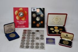 A box of coins to include large quantity of commemoration coins and year sets, some proof mostly