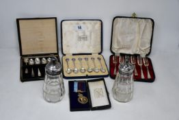 A box of silver to include mixed lot of cased spoon sets, masonic items, silver backed mirror,