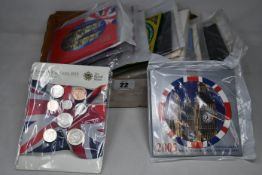 A box of coin year sets to include twenty two Royal Mint uncirculated year sets 1987 onwards with