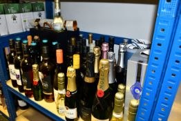 A shelf containing wines/champagnes to include Taittinger, Mead, Moet and Chandon (Over 18s only).