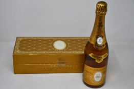 A bottle of Marque Depose Louis Roederer 1995 Champagne in presentation box (Over 18s only).
