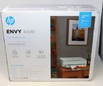 A boxed as new HP Envy 6020 All in One Wireless Printer (P/N: 5SE16B) (Box open, some damage to