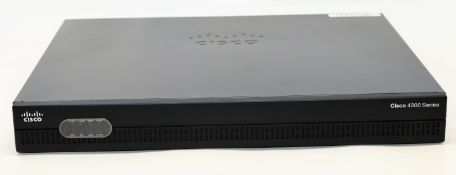 A boxed Cisco Integrated Services Router 4321 AX Bundle(Model: ISR4321-AX/K9 Z800-44681-05) (Appears