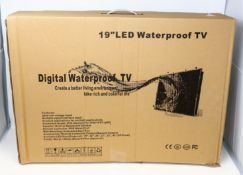 """A boxed as new unbranded 19"""" LED Waterproof TV (UK plug and remote included) (Box opened, some"""