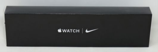 A boxed as new Apple Watch Nike Series 6 GPS + Cellular 44mm in Space Grey Aluminium Case and Nike