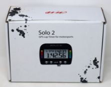 A boxed as new AIM Motorsport Solo 2 GPS Lap Timer (UK model).