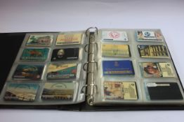 A collection of phone cards in an album.