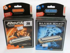 5 boxed as new Hohner harmonicas to include; Three a new rocket progressive harmonicas and two boxed