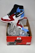 A pair of as new Nike AJ1 retro High OG Fearless (UK 9 - No box lid).