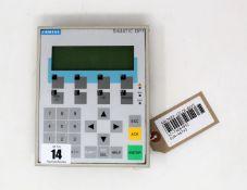A pre-owned Siemens Simatic OP7 Operator Panel (P/N: 6AV3607-1JC20-0AX1) (Back panel loose.