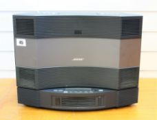 A pre-owned Bose Acoustic Wave II music system and multi disc changer (remote not included, power
