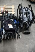 Four pre-owned pushchairs/buggies and a trolley.