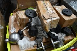 A quantity of gym weights and related items.