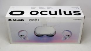 A boxed as new Oculus Quest 2 64GB VR Headset and hand controllers in white (damage to box sleeve)