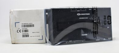 A boxed as new Creston 4 port HDMI distribution amplifier (PN: HD-MD4X1-4K-E) (Box opened) (Box
