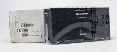 A boxed as new Creston 4 port HDMI distribution amplifier (PN: HD-MD4X1-4K-E) (Box damaged)