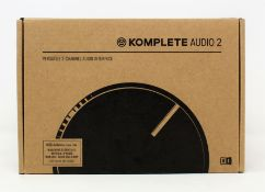A boxed as new Native Instruments Komplete Audio 2 USB Audio Interface (Box sealed).