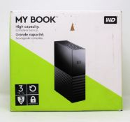 A boxed as new WD My Book 3TB desktop storage drive in black (Outer box damaged)