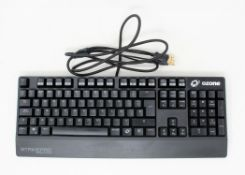 A boxed Ozone StrikePro Spectra mechanical RGB keyboard with cherry red switches. (PLEASE NOTE