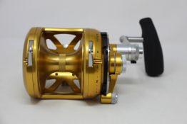 An as new Penn International 50VISX gold fishing reel.