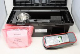 An as new Honeywell Searchline Excel alignment and conformity kit including handheld interrogator (