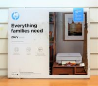 A boxed as new HP Envy 6020 all-in-one printer in white