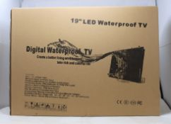 """A boxed as new unbranded 19"""" LED waterproof TV with remote in silver."""