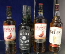 Two bottles of Famous Grouse blended Scotch whisky (1 x 700ml, 1 x 1ltr), a bottle of Bells