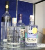 A bottle of Brecon Special Reserve gin (700ml), a bottle of Mediterranean Gin D'Azur (700ml), a