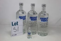 Three bottles of Absolut vodka (1ltr) together with a miniature (Over 18's only).