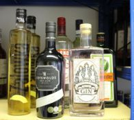 Eight bottles of assorted spirits to include Smirnoff vodka, The Three Graces Roses gin, Cotswolds