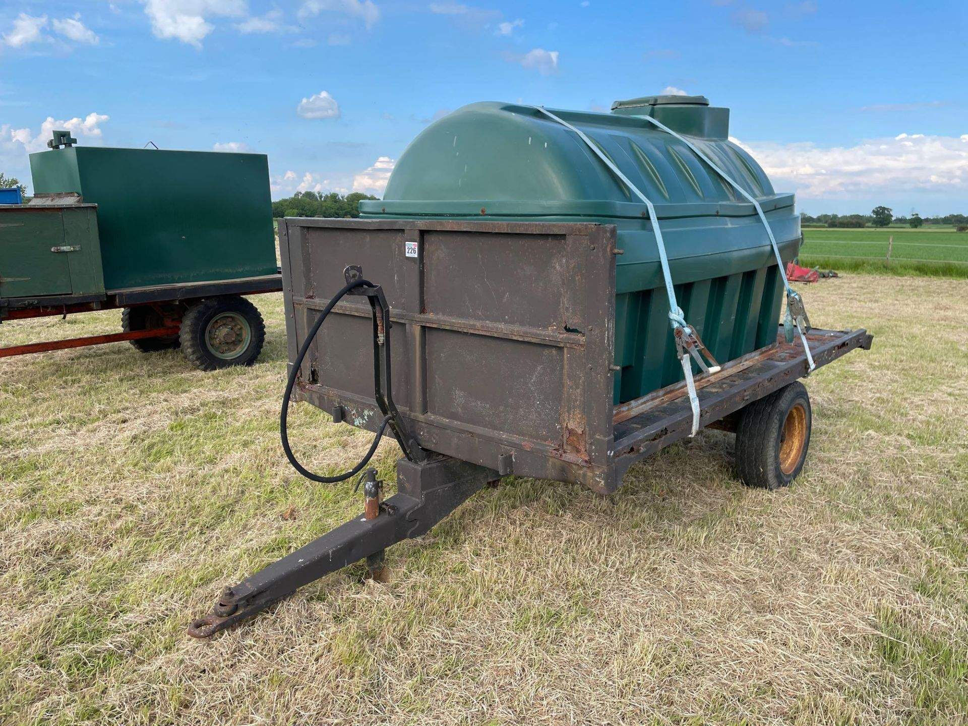 10 ft single axle trailer, wooden floor with Balmoral 2500l tank and 12v electric pump - Image 2 of 5