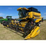 2011 New Holland CSX7060 combine harvester with 20ft Varifeed header on 800/65R32 front and 16.0/70-