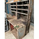 Metal workbench with pigeon holes and vice