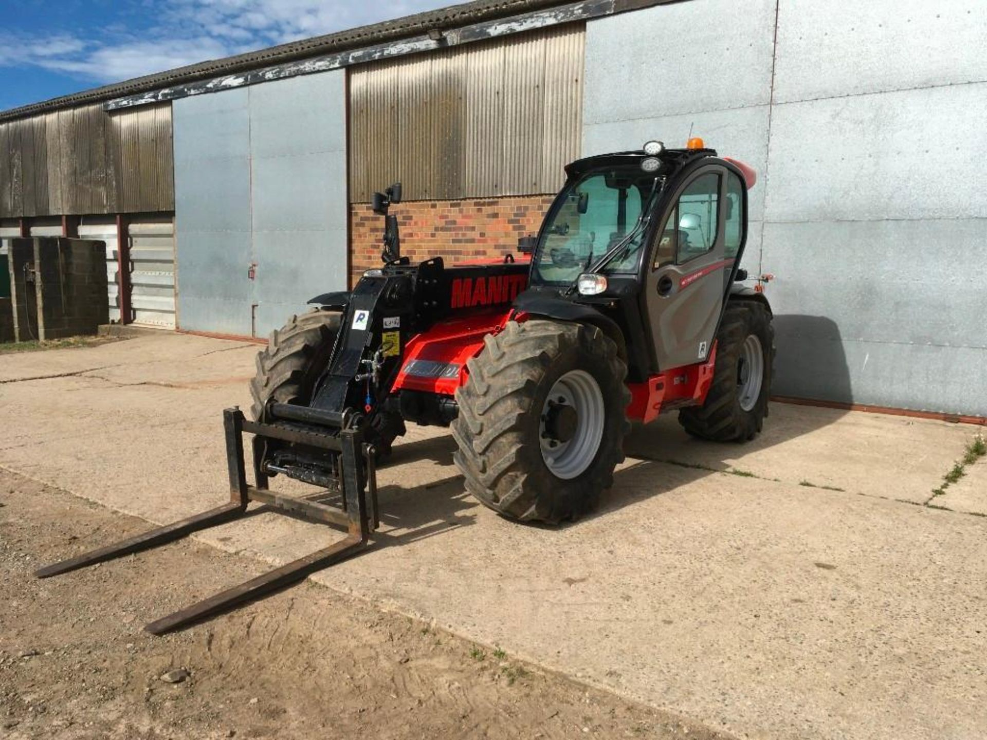 2017 Manitou MLT 737-130 PS+ Elite telehandler with rear pick up hitch, power shift, air seat, elect